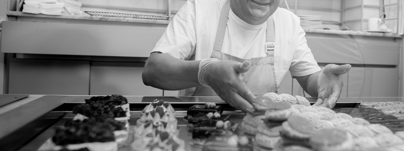 Pastry chef with cakes