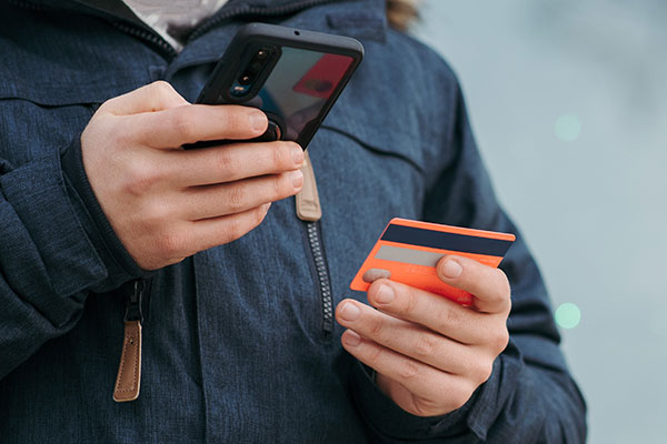 Man paying using his mobile phone