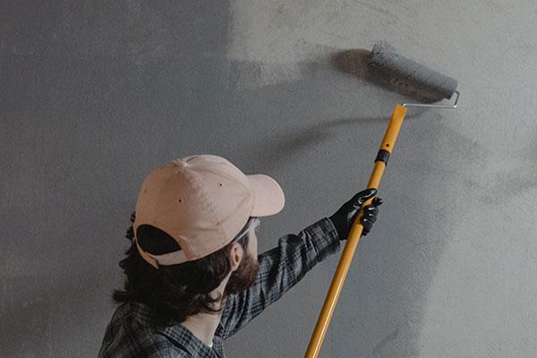 Tradesman painting a wall